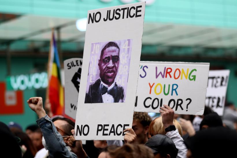 Protestors-march-down-Queen-Street-on-June-01-2020-in-Auckland-New-Zealand.jpg